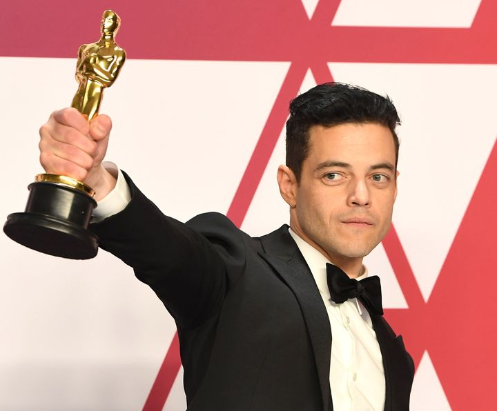 Rami Malek poses with his Oscar after the Academy Awards on Sunday.