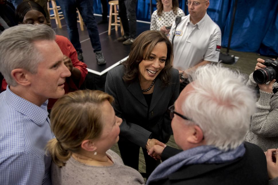 Harris greets people in Ankeny, Feb. 23. Many Iowans feel a sense of obligation to make sure they put the correct candid