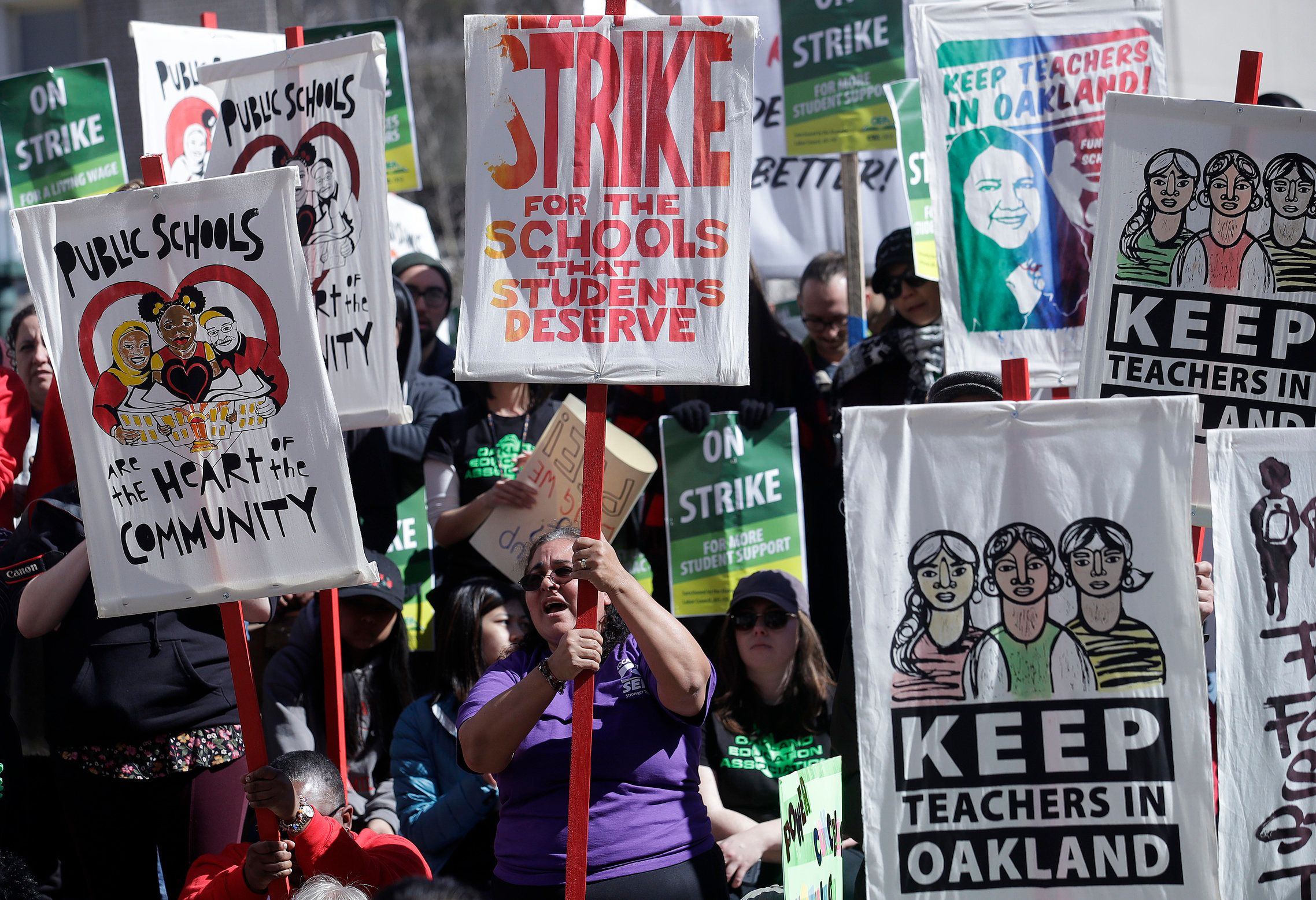 Teachers, students and supporters rally at Frank Ogawa Plaza in front of City Hall in Oakland, Calif., Thursday, Feb. 21, 2019. Teachers in Oakland, California, went on strike Thursday in the country's latest walkout by educators over classroom conditions and pay. (AP Photo/Jeff Chiu)