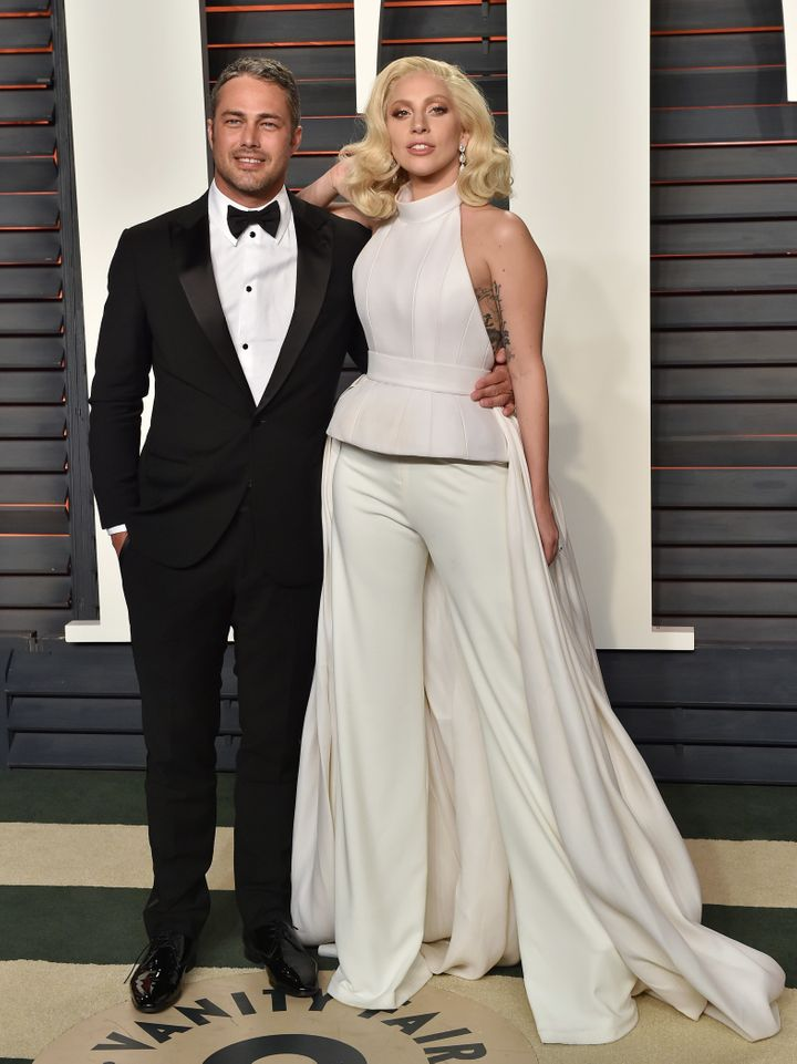 Taylor Kinney and Lady Gaga arrive at the 2016 Vanity Fair Oscars after-party.