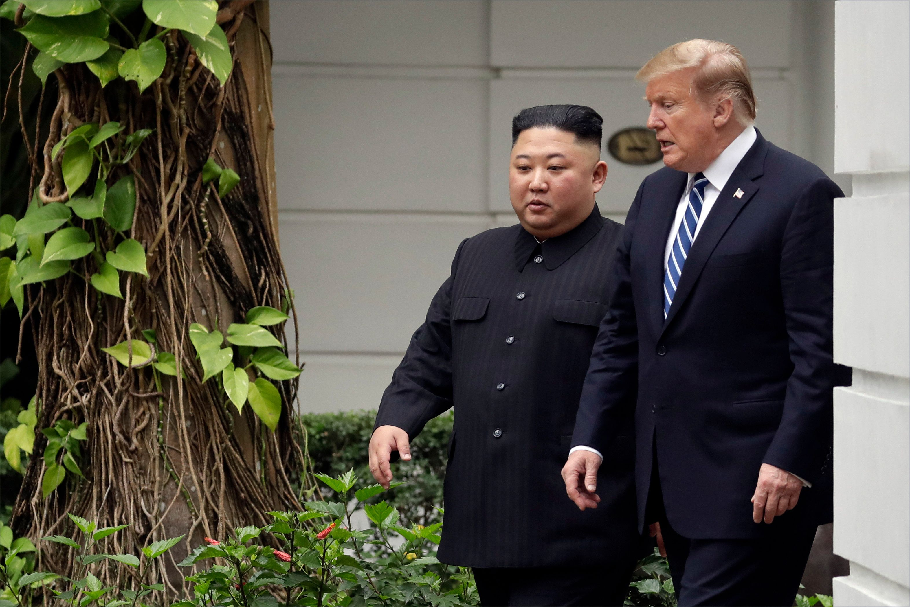 President Donald Trump and North Korean leader Kim Jong Un take a walk after their first meeting at the Sofitel Legend Metropole Hanoi hotel, Thursday, Feb. 28, 2019, in Hanoi. (AP Photo/Evan Vucci)