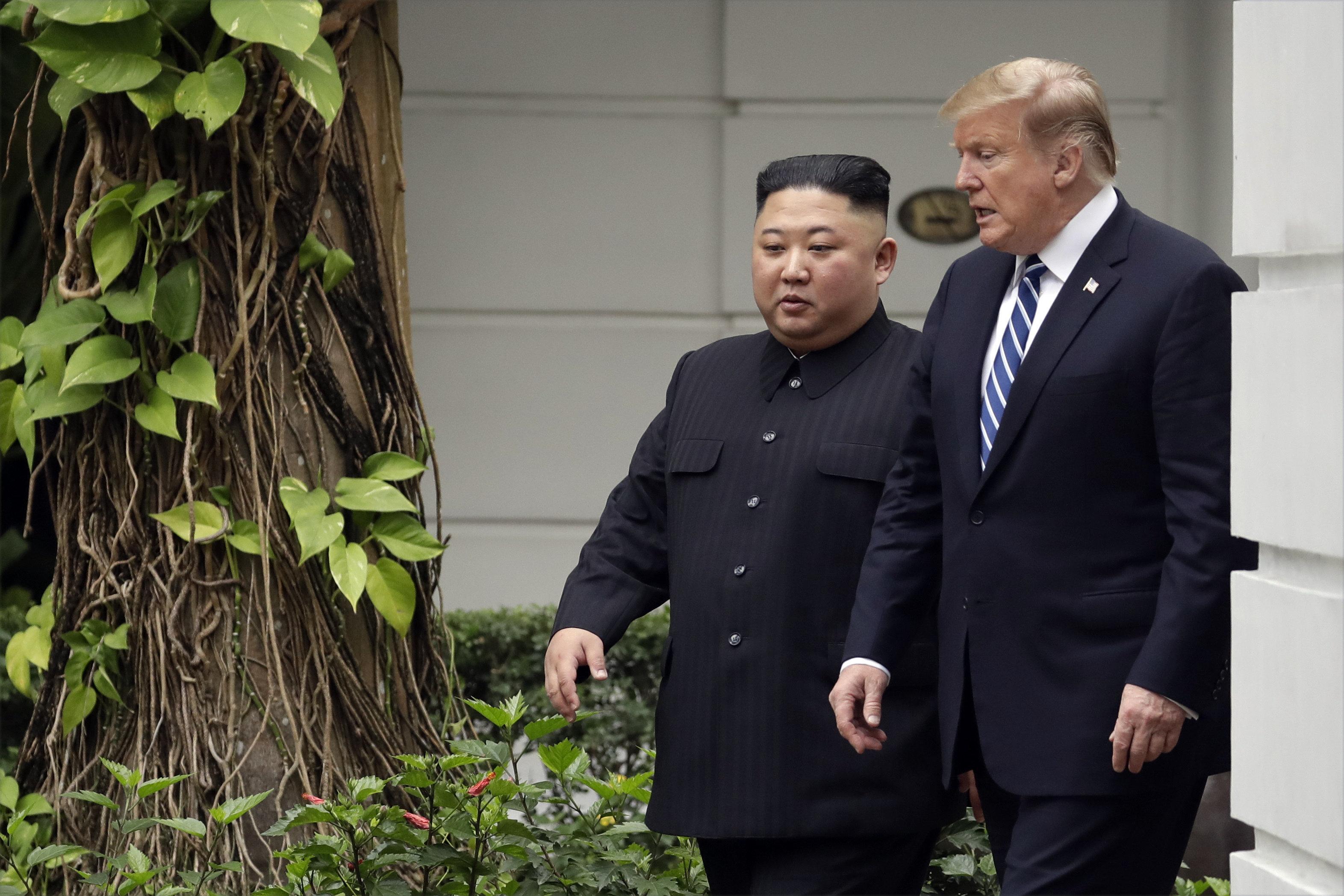 President Donald Trump and North Korean leader Kim Jong Un take a walk after their first meeting at the Sofitel Legend Metropole Hanoi hotel, Thursday, Feb. 28, 2019, in Hanoi. (AP Photo/Evan Vucci)