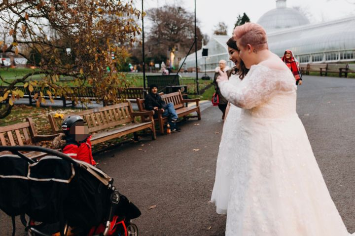 The brides met the young boy and his mom at Glasgow Botanic Gardens.
