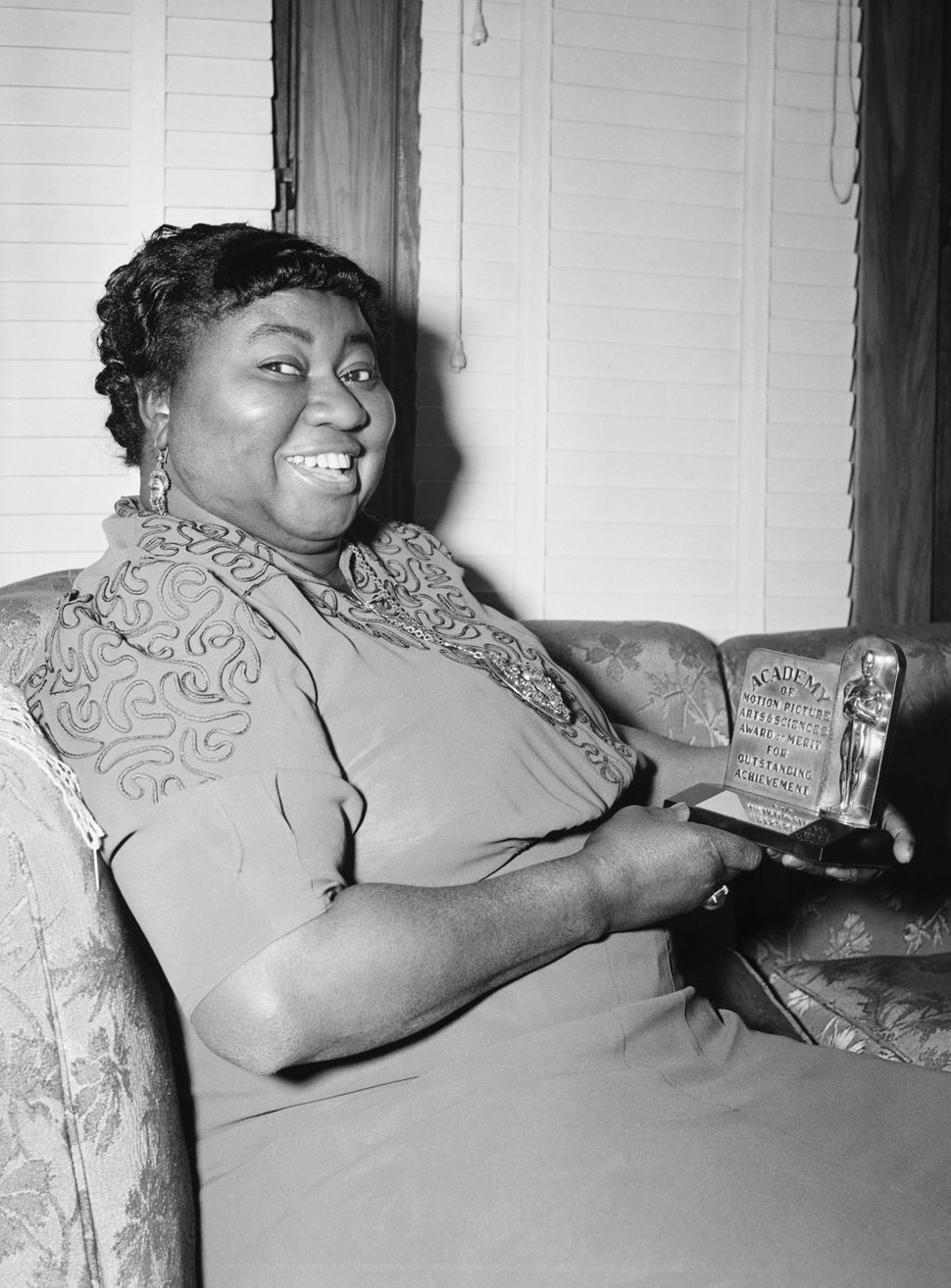 "Hattie McDaniel holds her Academy Award after being named ""Best Supporting Actress"" for her portrayal of ""Mammy"" in ""Gone wit"
