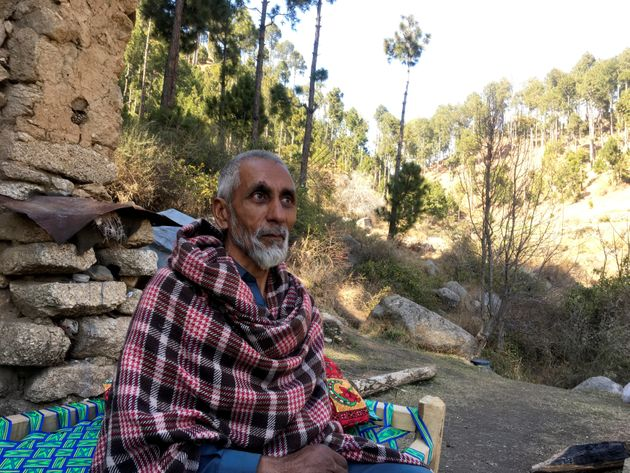 Nooran Shah, 62, talks during an interview with Reuters outside his home which is near to the site where...