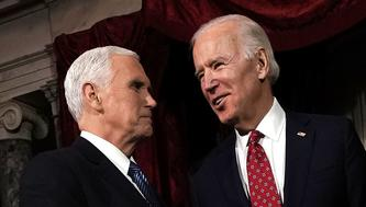 WASHINGTON, DC - JANUARY 03:  Former U.S. Vice President Joseph Biden (R) and incumbent U.S. Vice President Mike Pence (L) share a moment during a mock swearing-in ceremony for U.S. Sen. Doug Jones (D-AL) at the Old Senate Chamber of the U.S. Capitol January 3, 2018 in Washington, DC. Jones is the first Democratic senator from Alabama in more than two decades. He defeated Roy Moore leaving Republicans with a 51-49 majority in the U.S. Senate.  (Photo by Alex Wong/Getty Images)