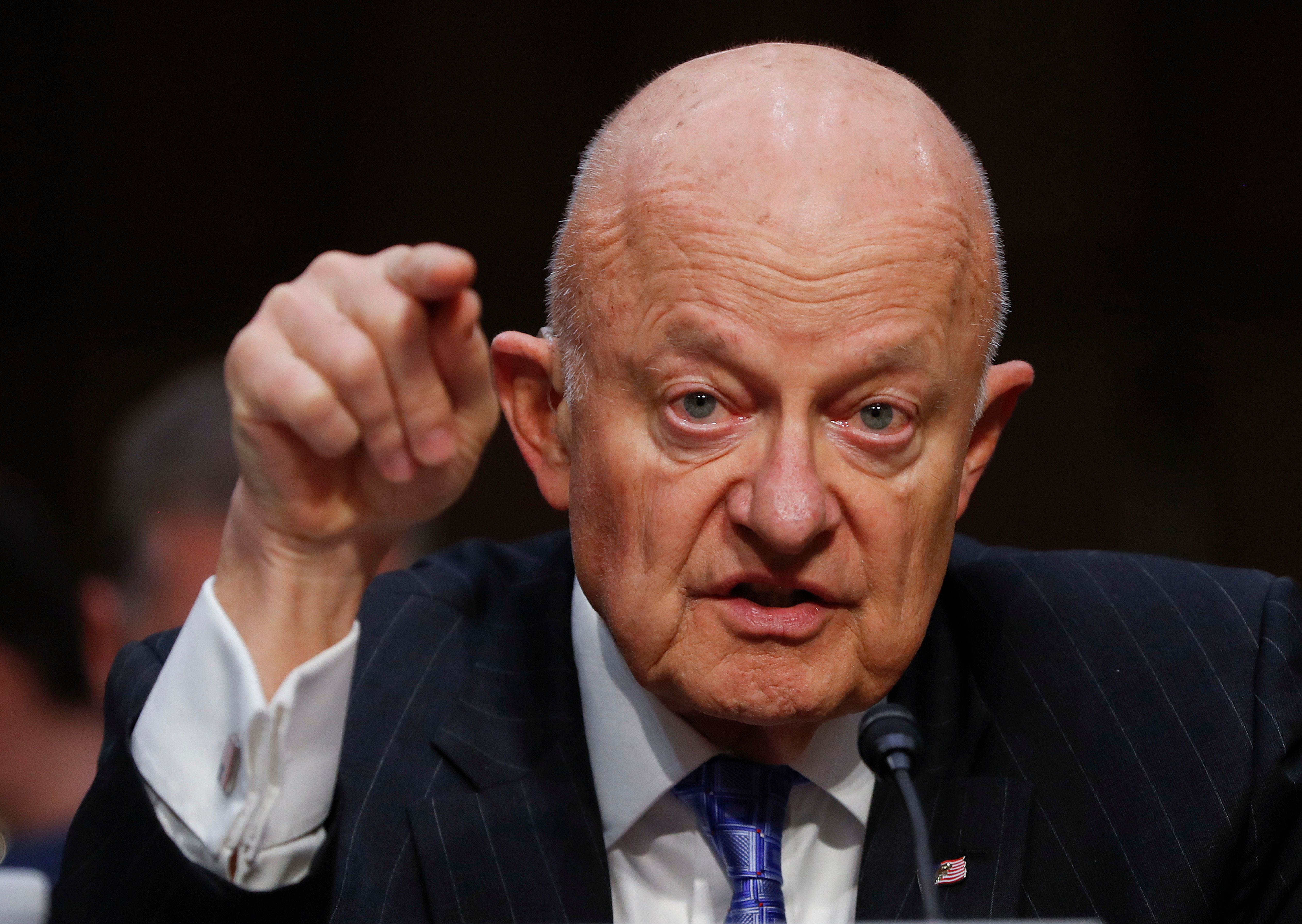 """FILE - In this Monday, May 8, 2017, file photo, former National Intelligence Director James Clapper testifies on Capitol Hill in Washington, before the Senate Judiciary subcommittee on Crime and Terrorism hearing: """"Russian Interference in the 2016 United States Election."""" Clapper on Sunday, May 14, described a U.S. government """"under assault"""" after President Donald Trump's controversial decision to fire FBI director James Comey, as lawmakers urged the president to select a new FBI director free of any political stigma. (AP Photo/Pablo Martinez Monsivais, File)"""