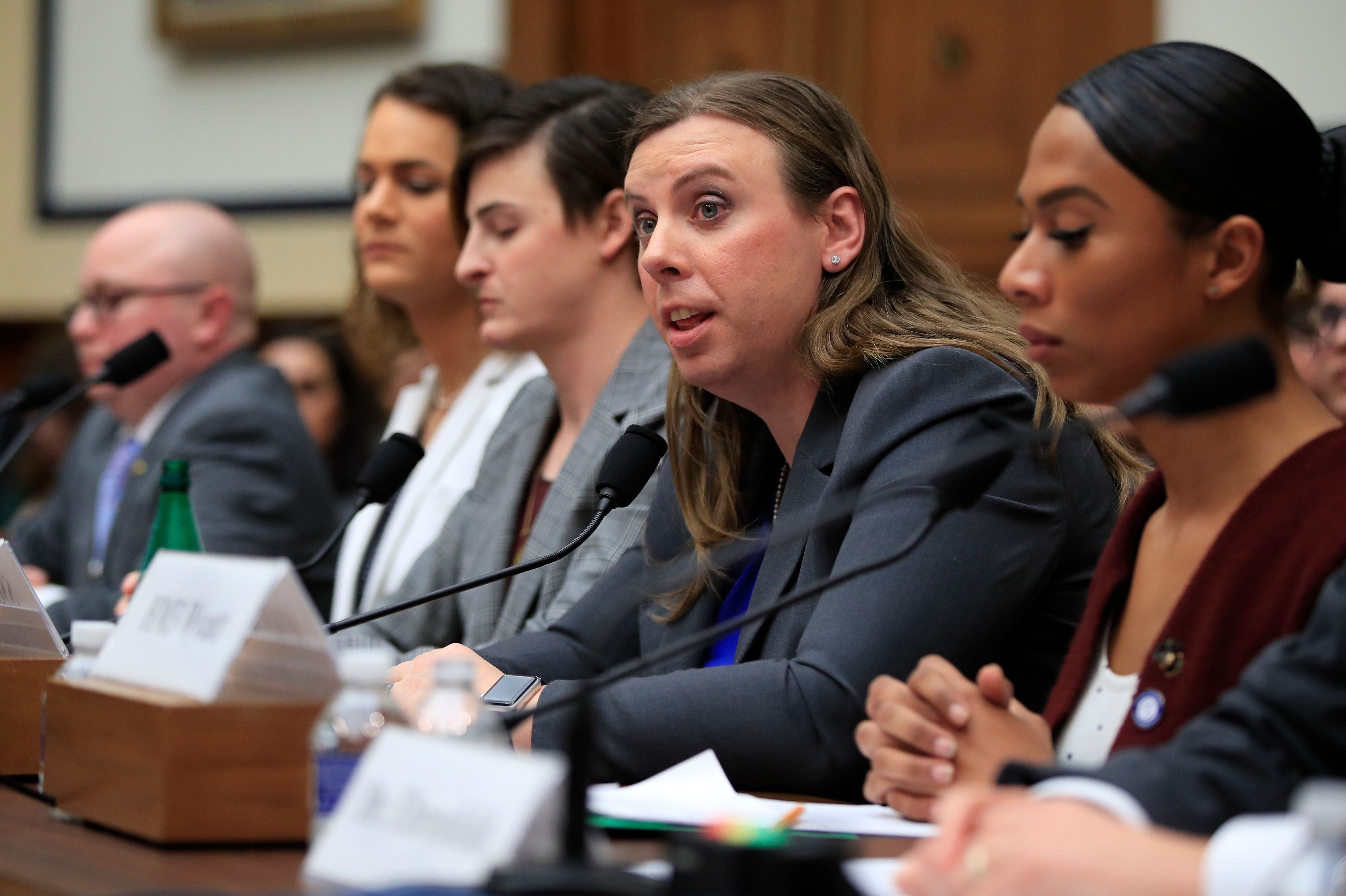 Army Staff Sgt. Patricia King, second from right, together with other transgender military members, from left, Navy Lt. Cmdr. Blake Dremann, Army Capt. Alivia Stehlik, Army Capt. Jennifer Peace and Navy Petty Officer Third Class Akira Wyatt, testify about their military service before a House Armed Services Subcommittee on Military Personnel hearing on Capitol Hill in Washington, Wednesday, Feb. 27, 2019, as the Trump administration pushes to ban them. King was deployed three times to Afghanistan. (AP Photo/Manuel Balce Ceneta)