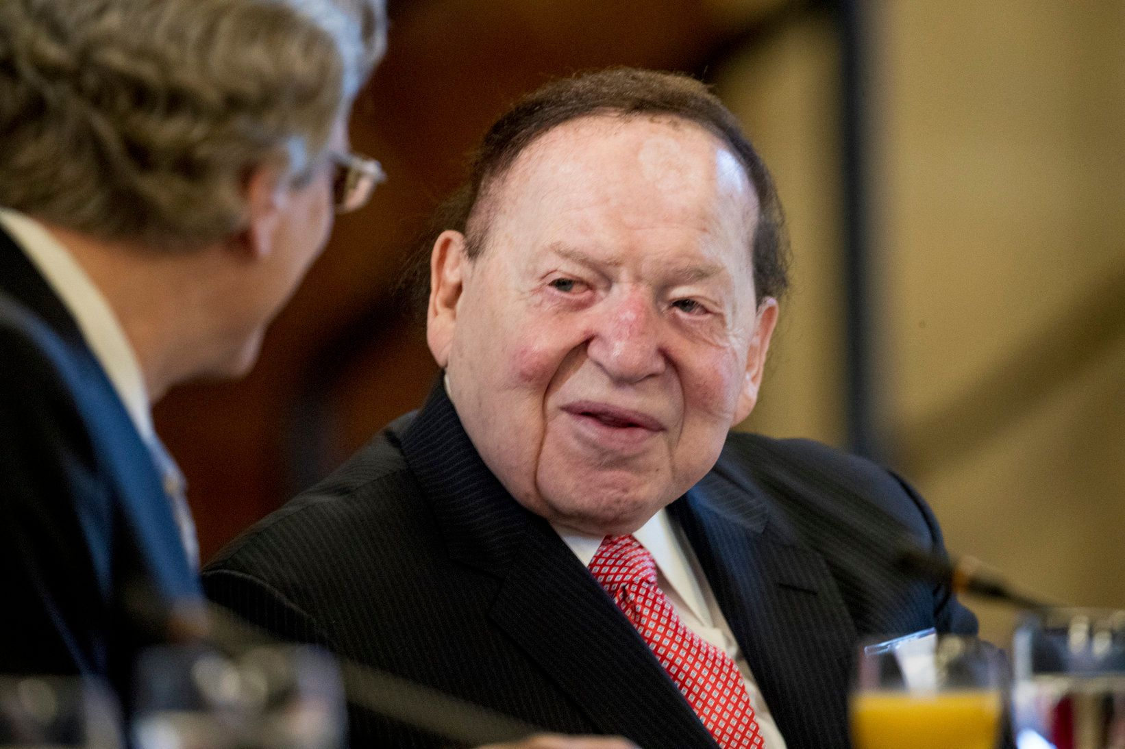FILE - In this Feb. 10, 2017 file photo, Chief Executive of Las Vegas Sands Corporation Sheldon Adelson is seen at a business roundtable with Japanese Prime Minister Shinzo Abe at the U.S. Chamber of Commerce in Washington. Adelson is not in good health and has not being at his company's offices in Las Vegas since around Christmas Day, 2018. Adelson's poor health was revealed Monday, Feb. 25, 2019 by one of his company's attorneys during a court hearing in a years-old case brought by a Hong Kong businessman. Attorney James Jimmerson told the court the condition of the 85-year-old billionaire is dire. (AP Photo/Andrew Harnik, File)