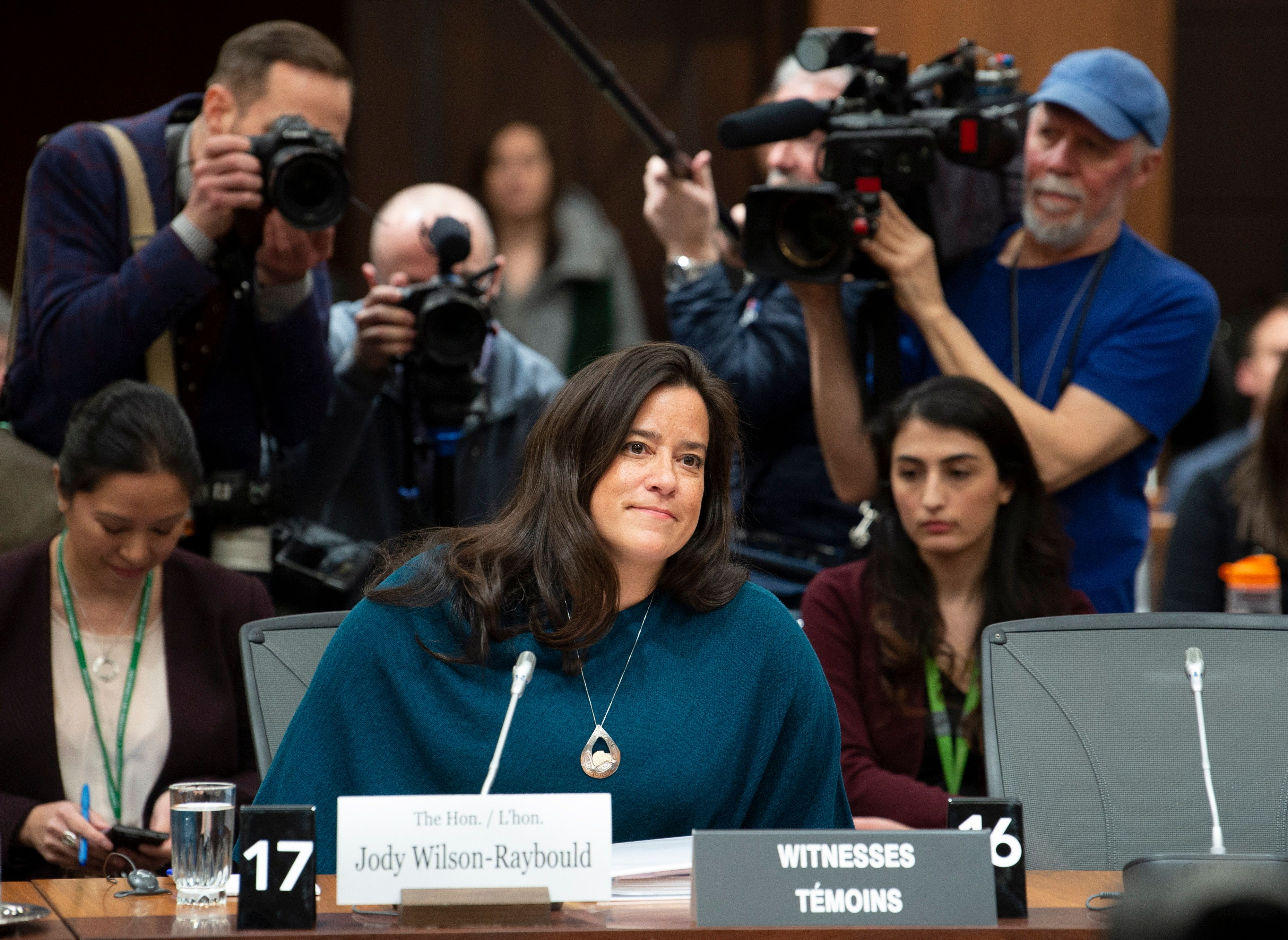 Cameras follow Jody Wilson Raybould as she waits to appear in front of the Justice committee in Ottawa