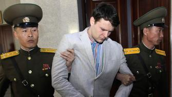 FILE - In this March 16, 2016, file photo, American student Otto Warmbier, center, is escorted at the Supreme Court in Pyongyang, North Korea. North Korea on Friday, Nov. 16, 2018, said it is expelling American Bruce Byron Lowrance after he slipped unlawfully into the police state known for its anti-U.S. fervor. (AP Photo/Jon Chol Jin, File)