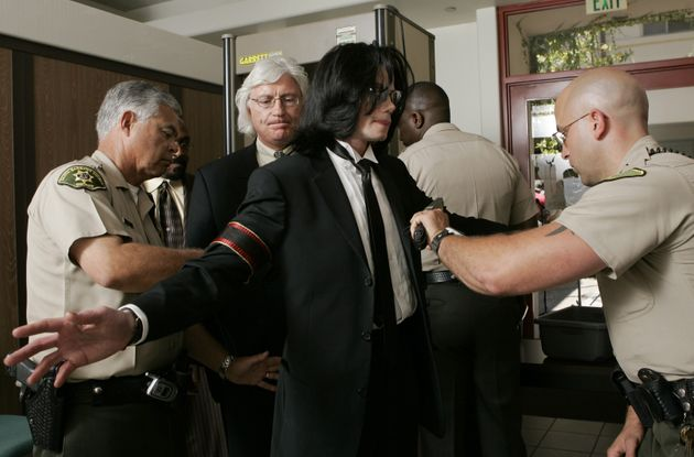 Michael Jackson and attorney Thomas Mesereau enter the Santa Barbara County Superior Court on June 13,