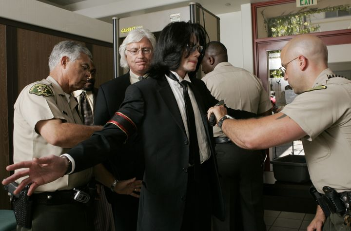 Michael Jackson and attorney Thomas Mesereau enter the Santa Barbara County Superior Court on June 13, 2005.