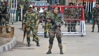 "Indian army soldiers stand guard outside integrated check post at Atari from where Indian fighter pilot Wing Commander Abhinandan Varthaman is to enter, at India Pakistan border Wagah, 28 kilometers (17.5 miles) from Amritsar, India, Friday, March 1, 2019. Pakistani officials brought a captured Indian pilot to a border crossing with India for handover on Friday, a ""gesture of peace"" promised by Pakistani Prime Minister Imran Khan amid a dramatic escalation with the country's archrival over the disputed region of Kashmir. (AP Photo/Prabhjot Gill)"