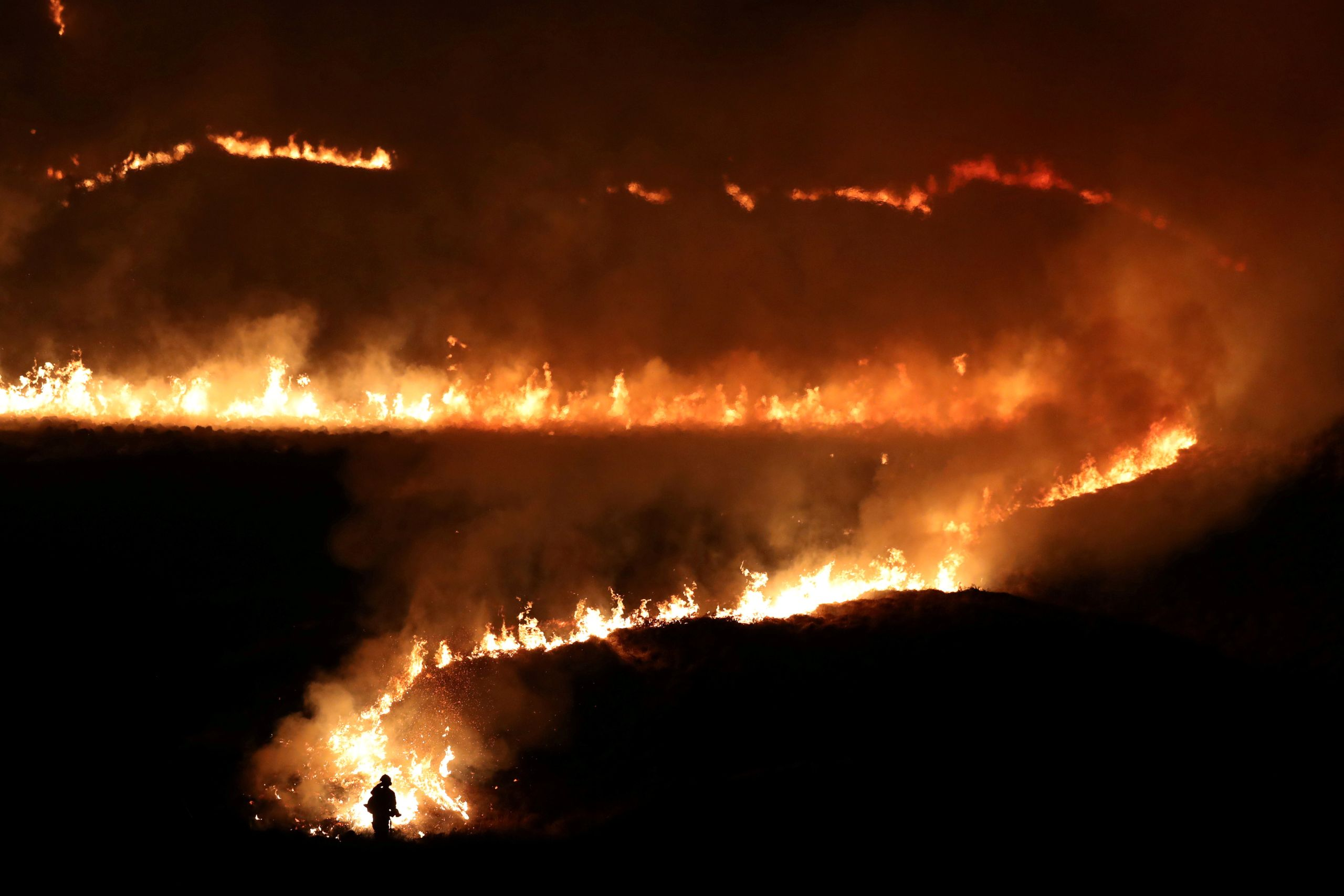 A fire is seen burning on Saddleworth Moor near the town of Diggle, England, Feb. 27, 2019.