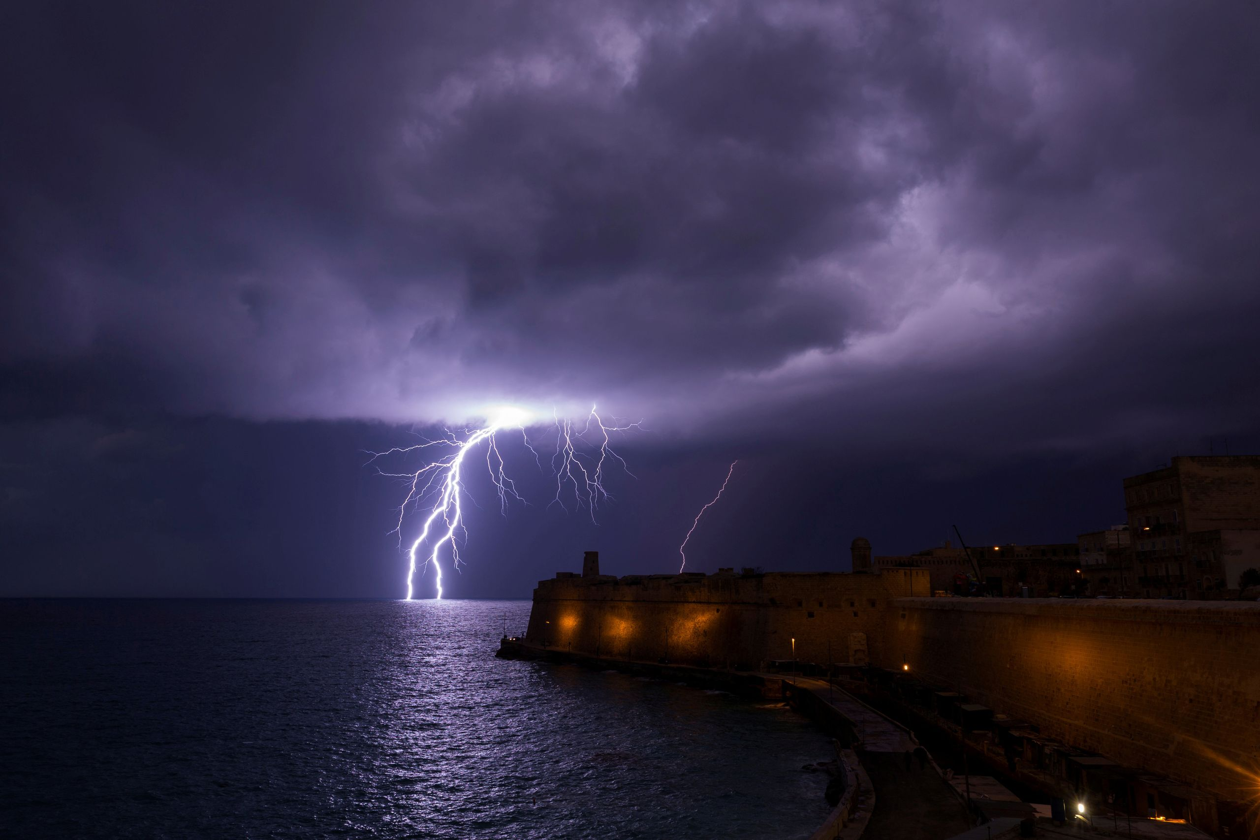 A lightning bolt strikes the sea near Fort St. Elmo during a storm in Valletta, Malta, Feb. 27, 2019.