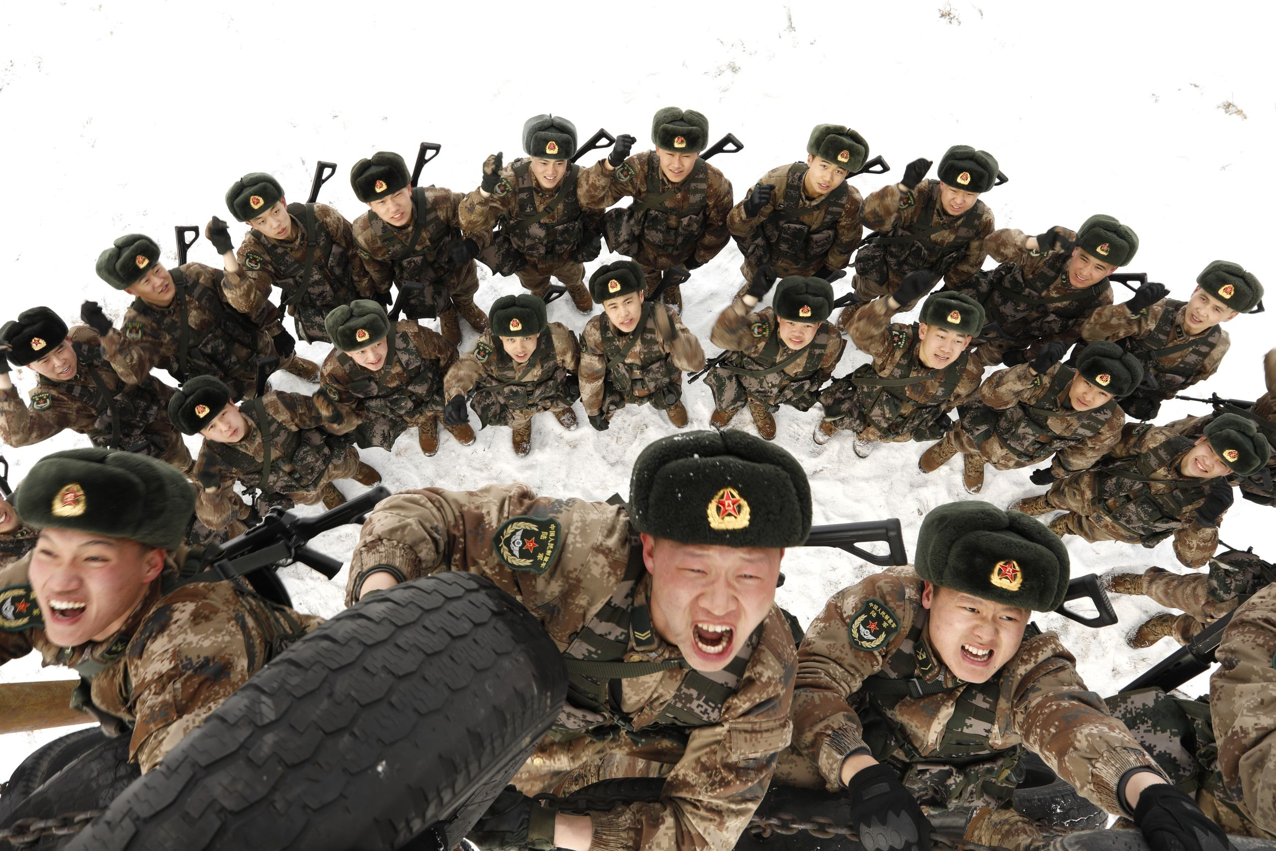 Frontier soldiers climb a tire-wall in a drill on Feb. 27, 2019, in Heihe, China.