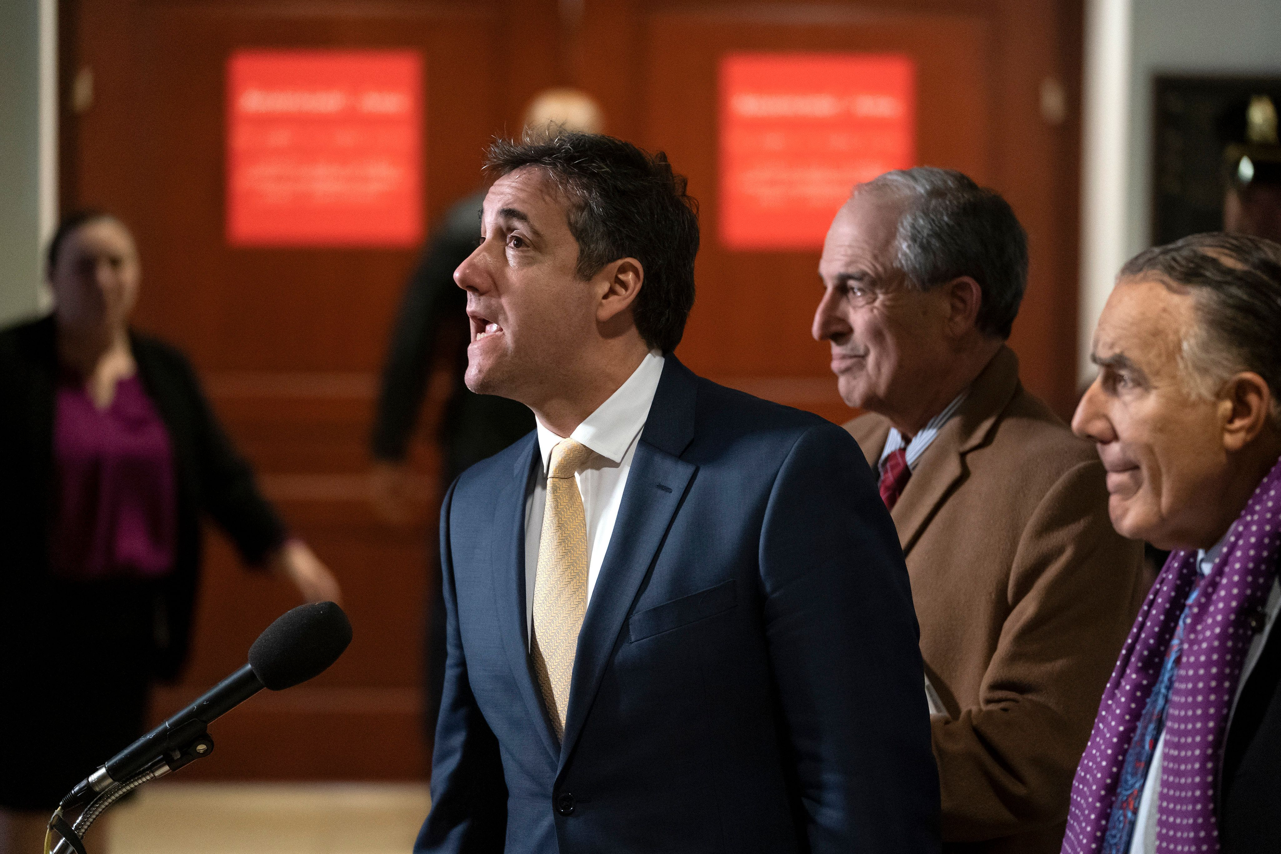 President Donald Trump's former lawyer, Michael Cohen, joined at right by his attorneys Lanny Davis and Michael Monico, leaves a closed-door interview with the House Intelligence Committee at the end of three days of congressional testimony on Capitol Hill in Washington, Thursday, Feb. 28, 2019. (AP Photo/J. Scott Applewhite)