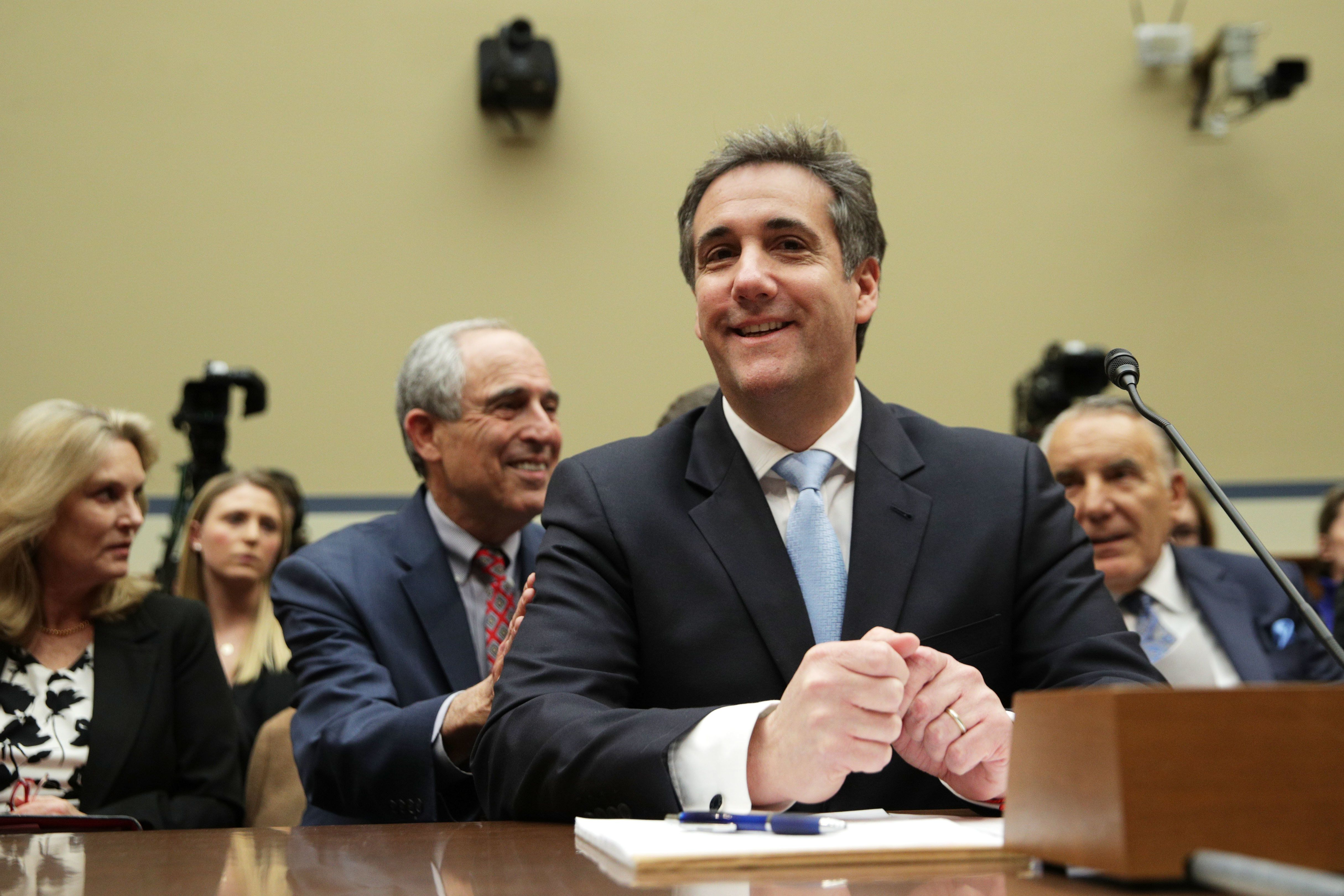 WASHINGTON, DC - FEBRUARY 27:  Michael Cohen, former attorney and fixer for President Donald Trump, shares a moment with his lawyer Lanny Davis as he testifies before the House Oversight Committee on Capitol Hill February 27, 2019 in Washington, DC. Last year Cohen was sentenced to three years in prison and ordered to pay a $50,000 fine for tax evasion, making false statements to a financial institution, unlawful excessive campaign contributions and lying to Congress as part of special counsel Robert Mueller's investigation into Russian meddling in the 2016 presidential elections. (Photo by Alex Wong/Getty Images)