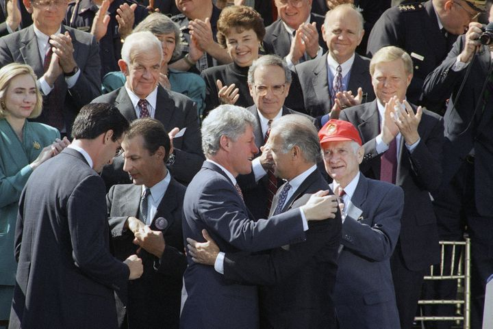 President Bill Clinton hugs then-Sen. Joe Biden in 1994 after signing the Violent Crime Control Act.
