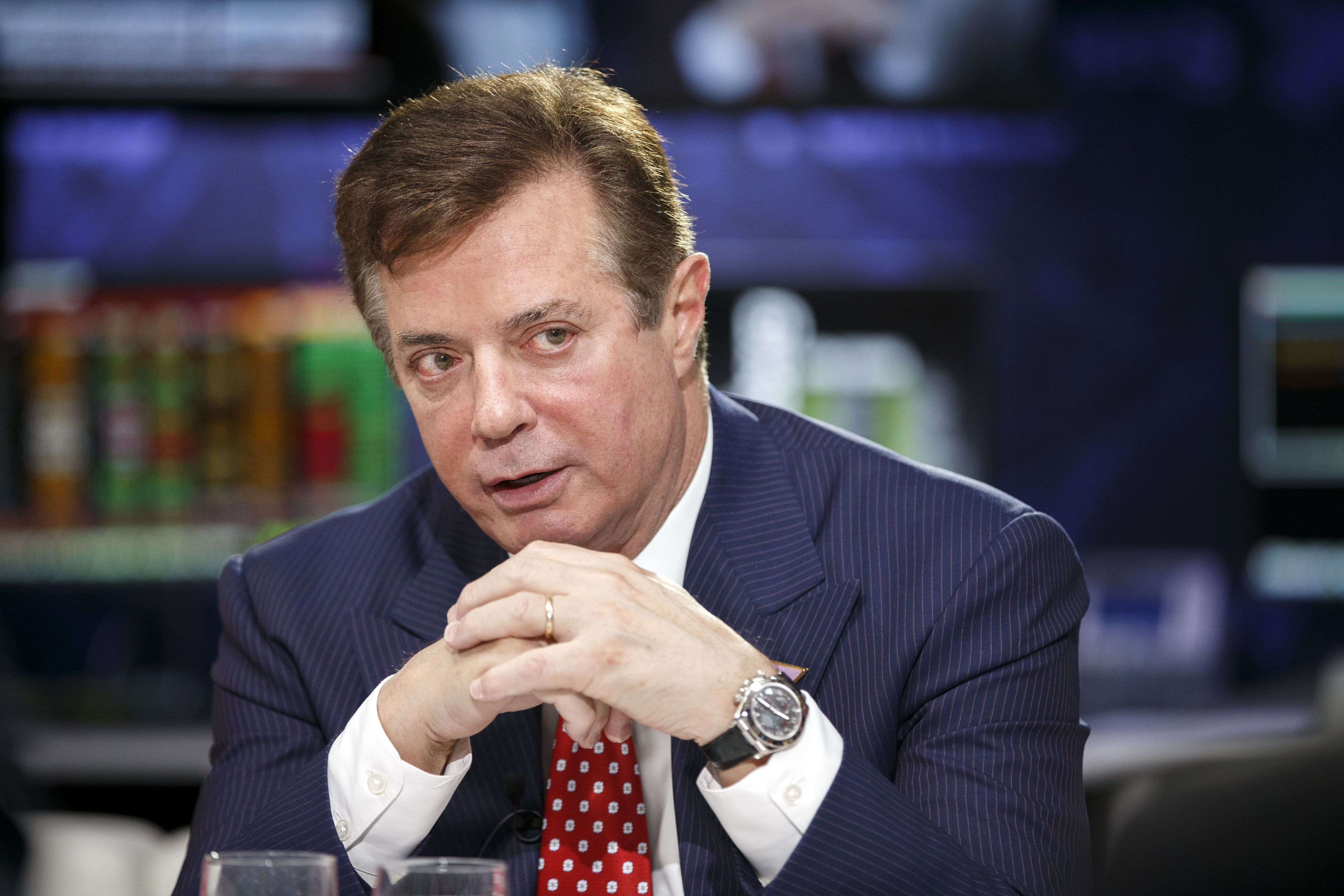 FILE: Paul Manafort, a campaign manager for presumptive 2016 Republican Presidential nominee Donald Trump, speaks during a Bloomberg Politics interview on the sidelines of the Republican National Convention (RNC) in Cleveland, Ohio, U.S., on Monday, July 18, 2016. Manafort, a former campaign manager for President Donald Trump, and his onetime business partner Rick Gates were charged with conspiracy against the U.S., the first people charged in the broad investigation into Russian meddling with the U.S. election. Photographer: Patrick Fallon/Bloomberg via Getty Images
