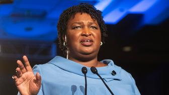 Georgia Democratic gubernatorial candidate Stacey Abrams addresses supporters during an election night watch party, Tuesday, Nov. 6, 2018, in Atlanta. Abrams spoke about expecting a runoff with Republican opponent Brian Kemp. (AP Photo/John Amis)