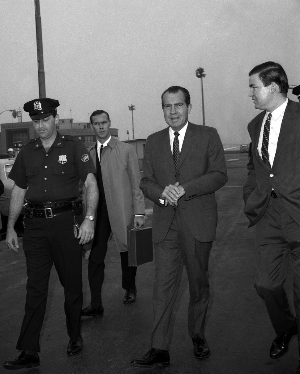 In 1971, then-President Richard Nixon followed the advice of conservative adviser Pat Buchanan (right) and vetoed a major chi