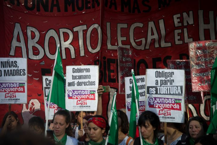 Demonstrators in Buenos Aires protest the country's abortion policy after a child gave birth to an underweight, premature bab