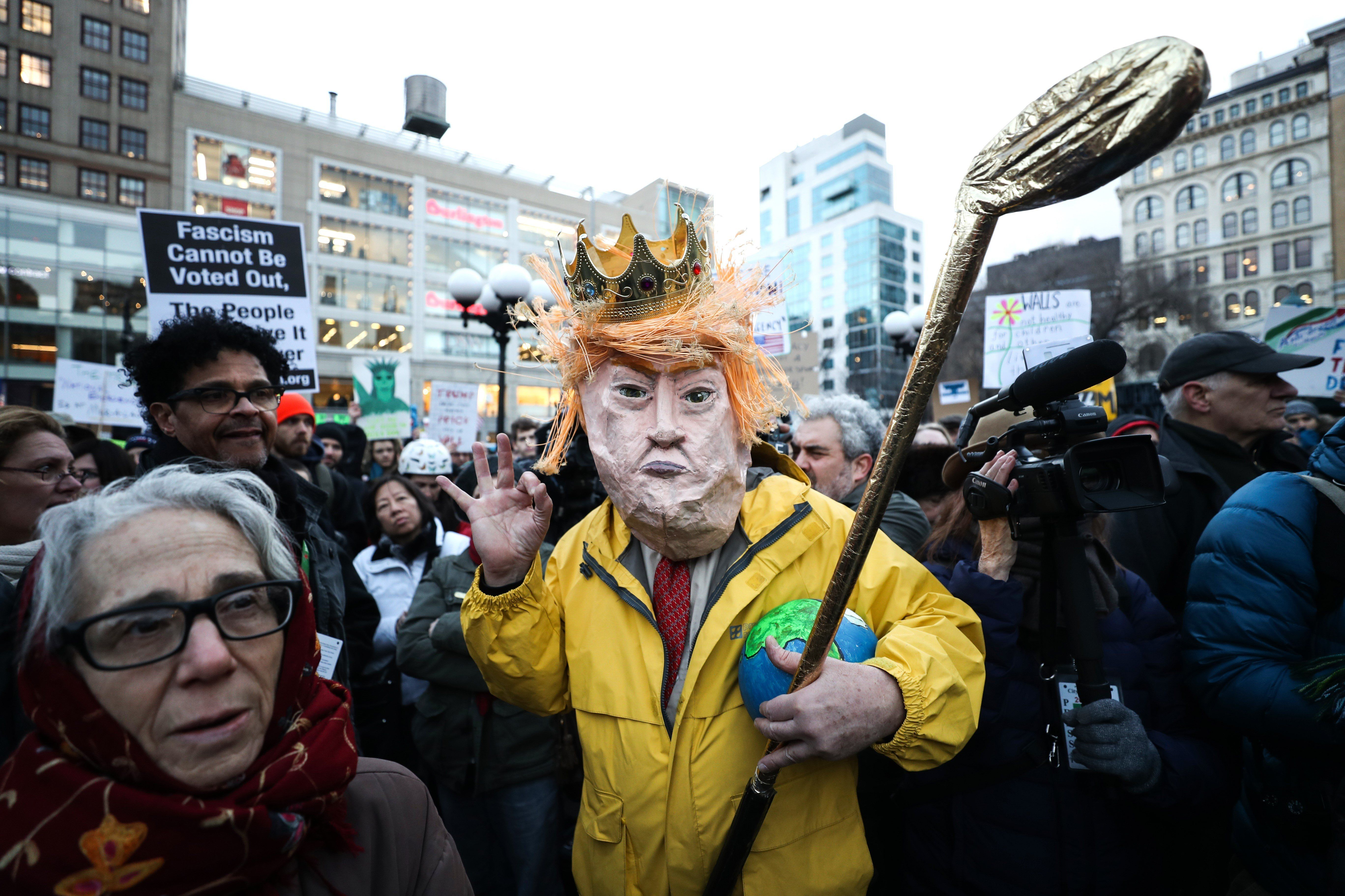 NEW YORK, UNITED STATES - FEBRUARY 18 : A man dressed in a mask as depicts US President Donald Trump hold golf bat during a President's Day protest against U.S. President Trump, and his immigration policy at Union Square in New York, United States on February 18, 2019. (Photo by Atilgan Ozdil/Anadolu Agency/Getty Images)