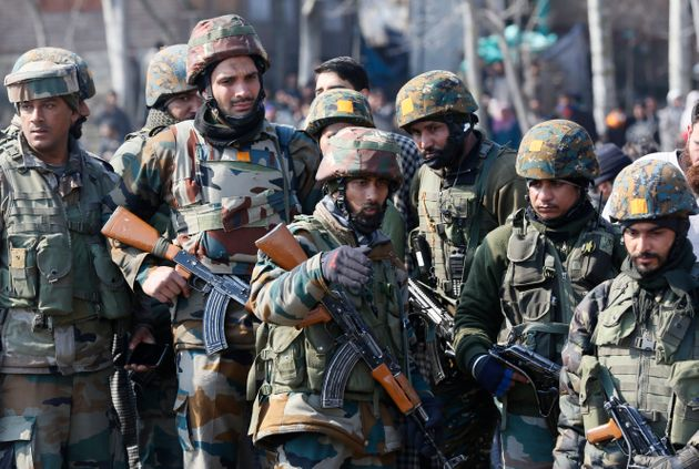 Indian security personnel in Kashmir in a file