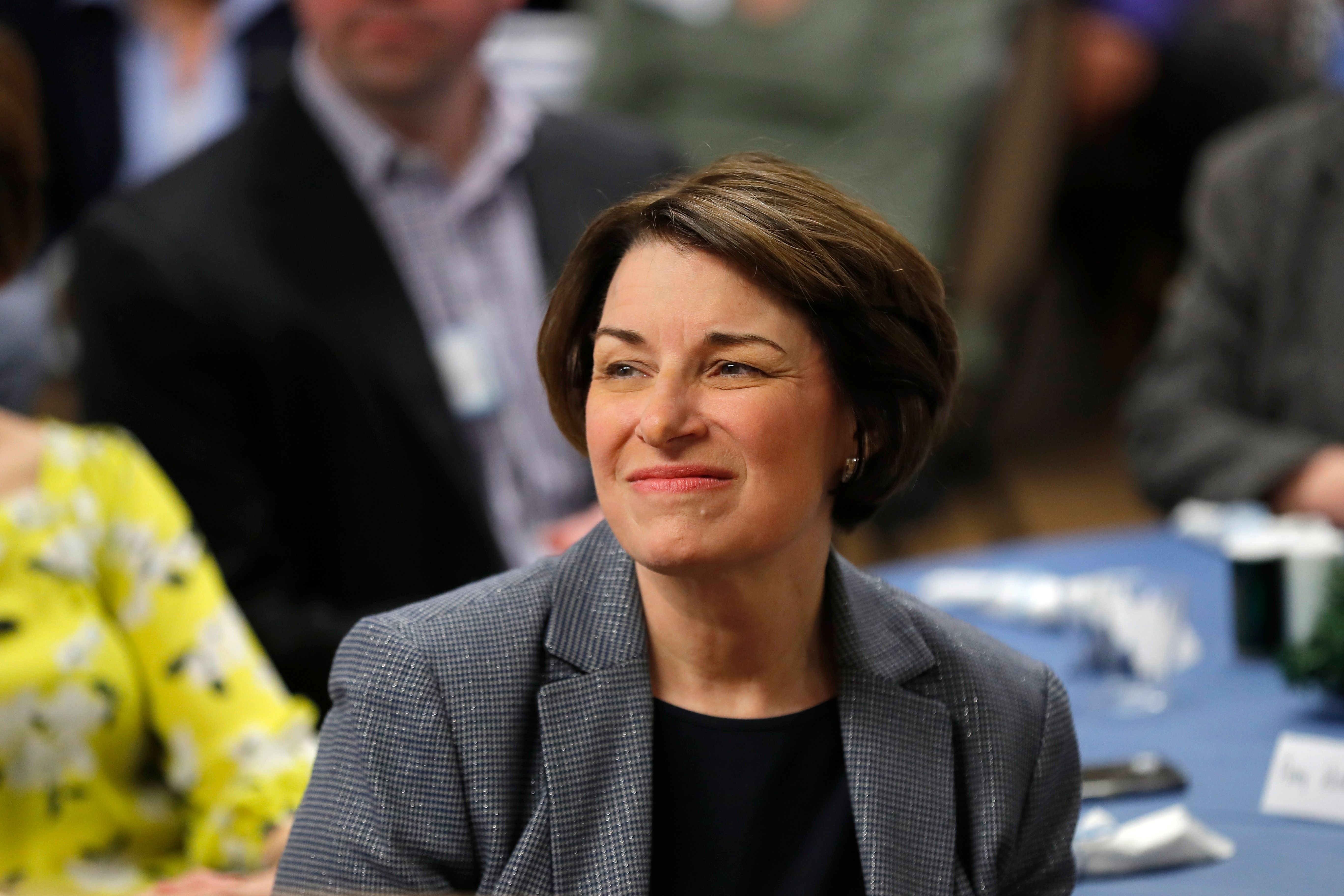 2020 Democratic presidential candidate Sen. Amy Klobuchar waits to speak at the Ankeny Area Democrats' Winter Banquet, Thursday, Feb. 21, 2019, in Des Moines, Iowa. (AP Photo/Charlie Neibergall)
