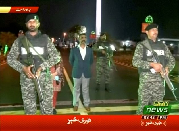 Indian pilot, Wing Commander Abhinandan, stands under armed escort near Pakistan-India border in Wagah,...