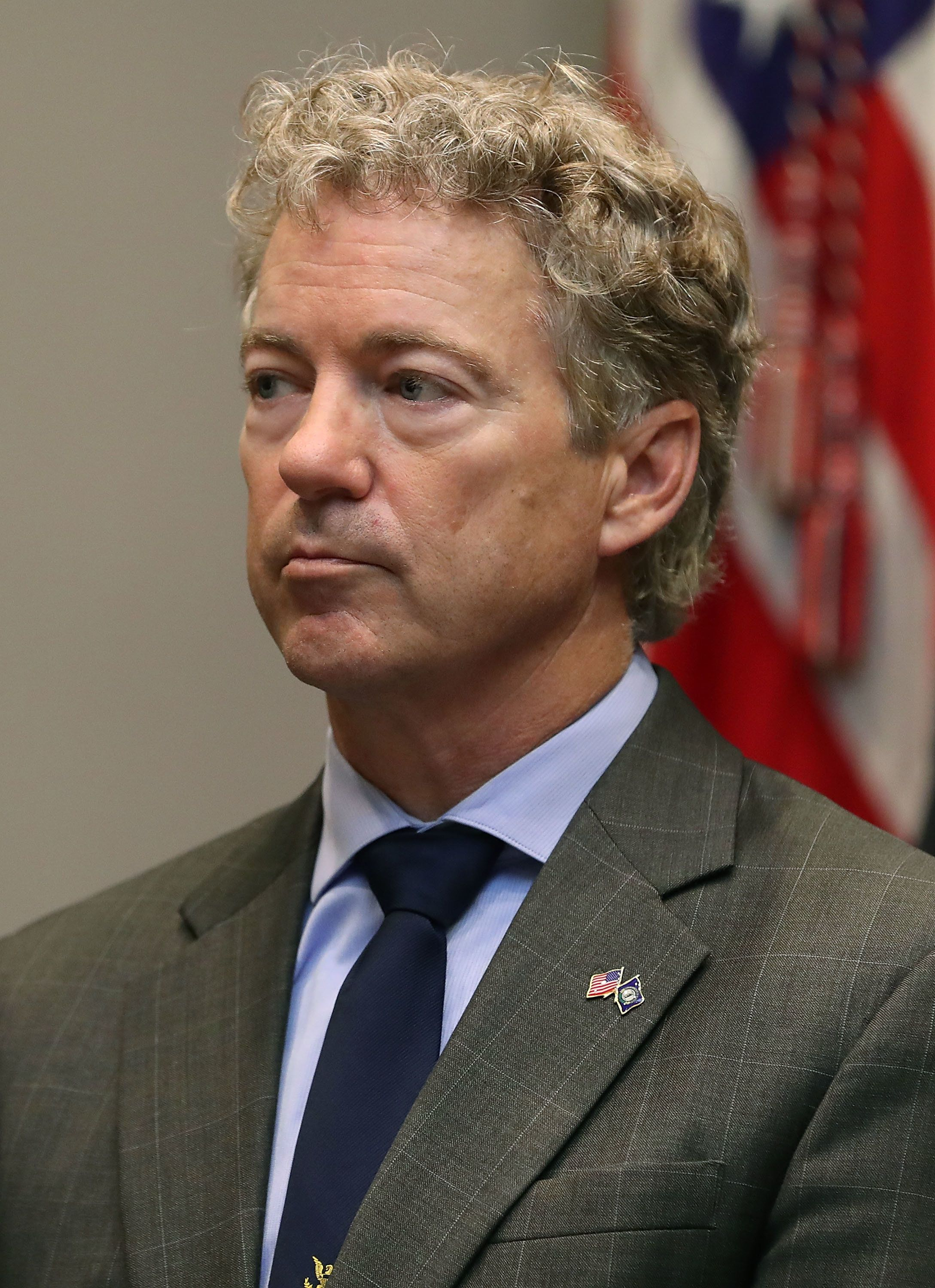 WASHINGTON, DC - NOVEMBER 14: Sen. Rand Paul (R-KY) listens to U.S. President Donald Trump make an announcement on the 'First Step Act', prison reform bill, in the Roosevelt Room at the White House on November 14, 2018 in Washington, DC.  (Photo by Mark Wilson/Getty Images)