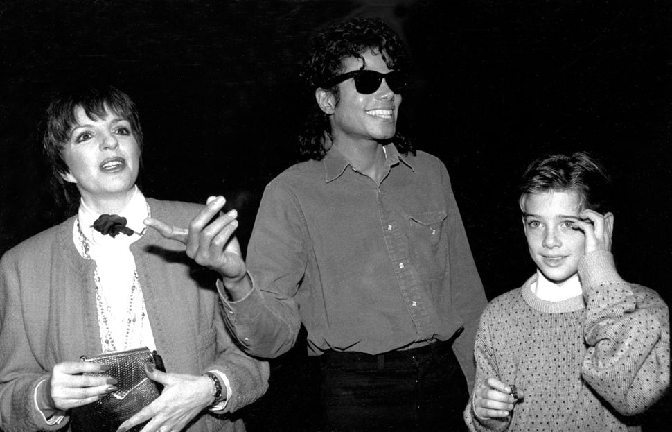 James Safechuck (right), then 10, with Michael Jackson and Liza Minnelli in 1988. The original photo caption refers to Safech