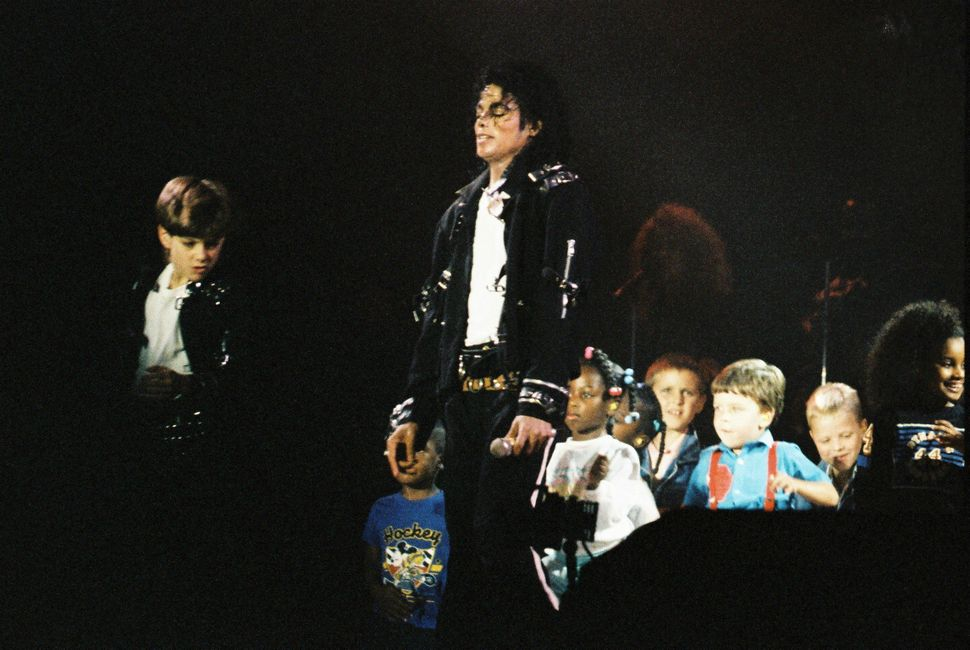 "Michael Jackson performing with children during his 1988 ""Bad"" tour."