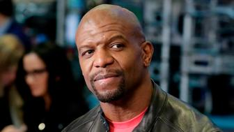 FILE - In this April 10, 2018 file photo, actor Terry Crews appears on the floor of the New York Stock Exchange in New York. Crews and agent Adam Venit have agreed to settle a lawsuit in which Crews alleged Venit groped him at a Hollywood party. Venit's agency William Morris Endeavor, also named as a defendant, confirmed the deal Thursday in a statement saying the lawsuit would be dismissed. (AP Photo/Richard Drew, File)