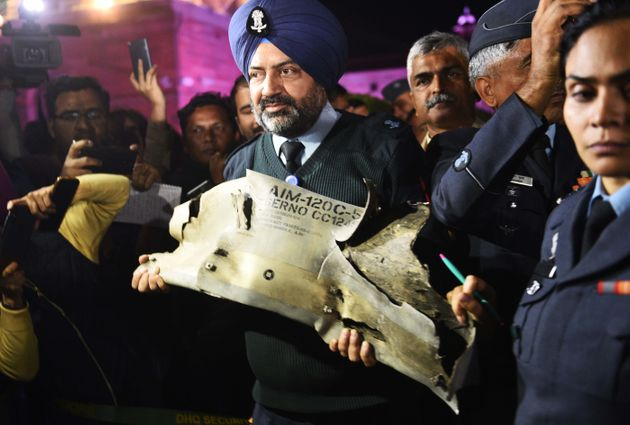 Indian Air Force officials show sections of an exploded AMRAAM missile, said to be fired by Pakistan...