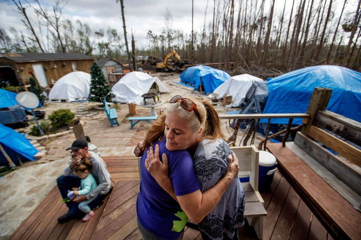 "Diahnn ""Shelly"" Summers, right, embraces Lori Hogan, who is currently living in a tent in Summers' backyard months after Hurr"