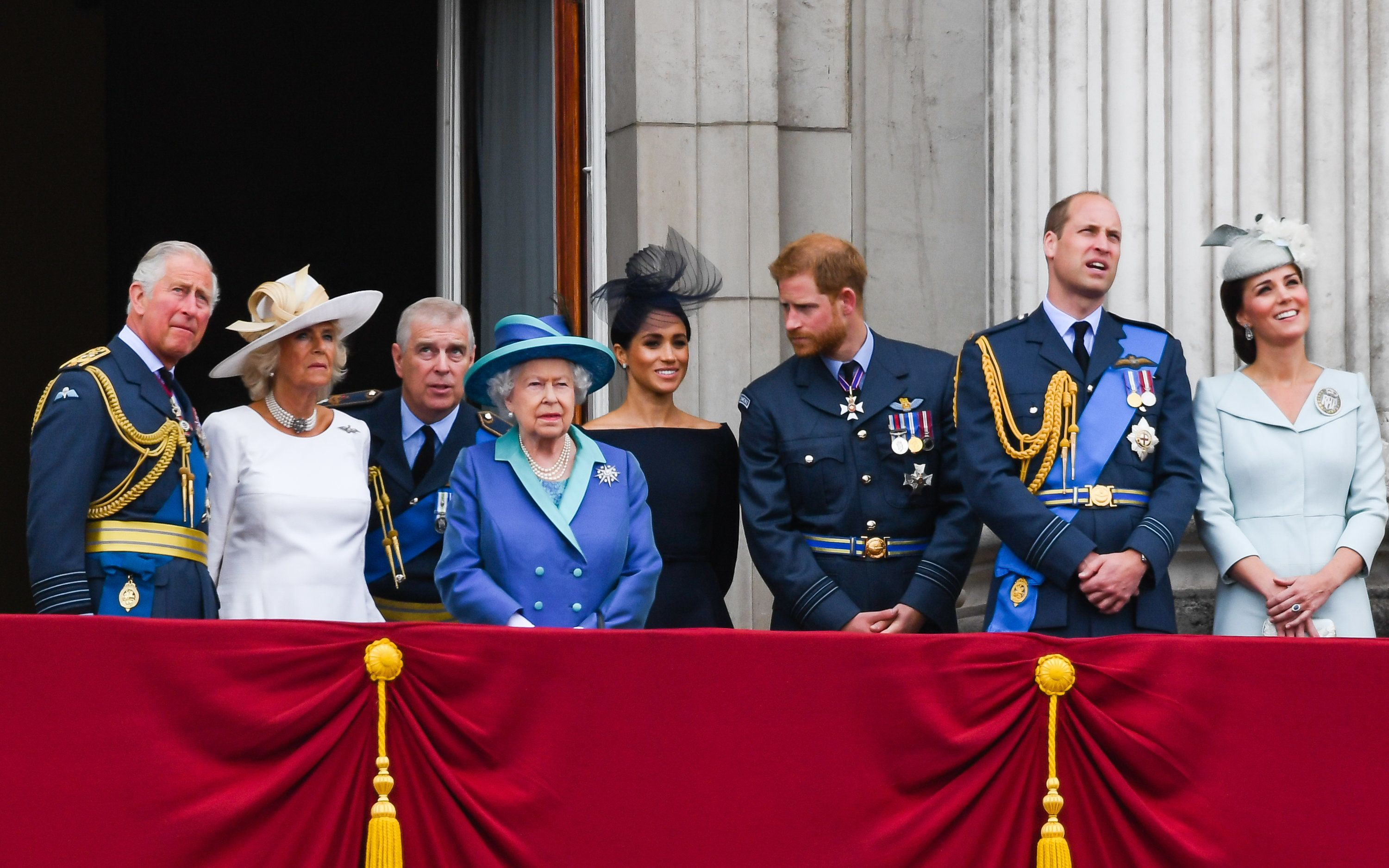 LONDON,  UNITED KINGDOM - JULY 1O:   Prince Charles, Prince of Wales, Camilla, Duchess of Cornwall, Prince Andrew, Duke of York,  Queen Elizabeth ll, Meghan, Duchess of Sussex, Prince Harry, Duke of Sussex, Prince William, Duke of Cambridge and Catherine, Duchess of Cambridge stand on the balcony of Buckingham Palace to view a flypast to mark the centenary of the Royal Air Force (RAF)  on July 10, 2018 in London, England. (Photo by Anwar Hussein/WireImage)