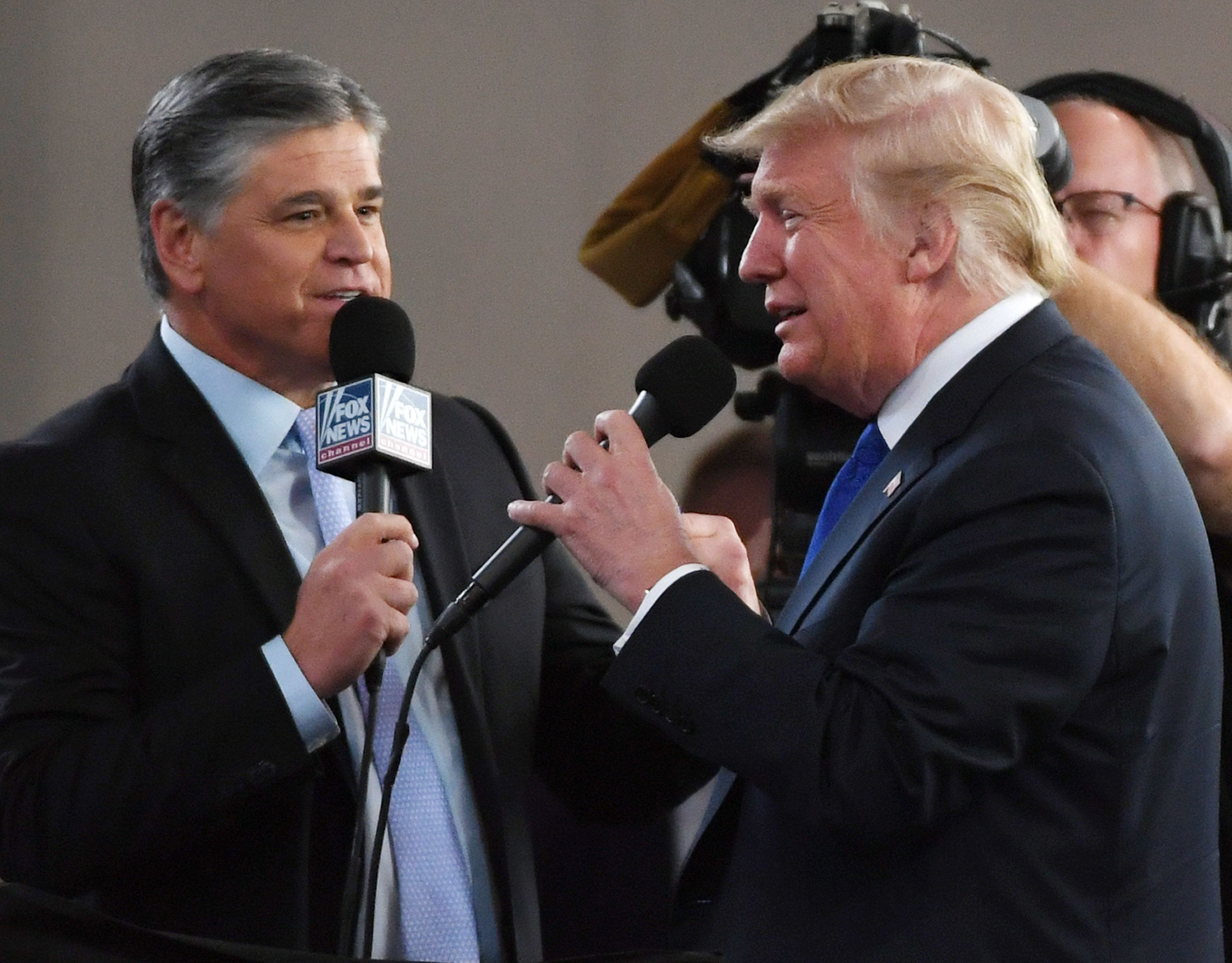 LAS VEGAS, NV - SEPTEMBER 20:  Fox News Channel and radio talk show host Sean Hannity (L) interviews U.S. President Donald Trump before a campaign rally at the Las Vegas Convention Center on September 20, 2018 in Las Vegas, Nevada. Trump is in town to support the re-election campaign for U.S. Sen. Dean Heller (R-NV) as well as Nevada Attorney General and Republican gubernatorial candidate Adam Laxalt and candidate for Nevada's 3rd House District Danny Tarkanian and 4th House District Cresent Hardy.  (Photo by Ethan Miller/Getty Images)