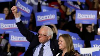Sen. Bernie Sanders, I-Vt., left, and his wife, Jane O'Meara Sanders, acknowledge supporters before leaving his 2020 presidential campaign stop at Navy Pier in Chicago, Sunday, March 3, 2019. Over the next several weeks, Sanders will travel to Iowa, New Hampshire, South Carolina, Nevada, and California. He will then return to Burlington, Vt., for the official launch of his campaign. (AP Photo/Nam Y. Huh)