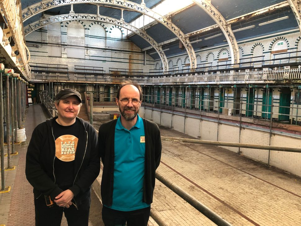 Viv Harrison and Mark Gunton, trustees of Moseley Road Baths in the second pool, which is yet to be