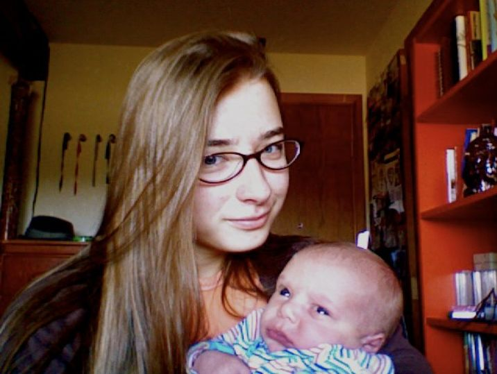 Cynthia Jeub, 19 years old, holding baby No. 16, Elijah, in Monument, Colorado, in 2011.