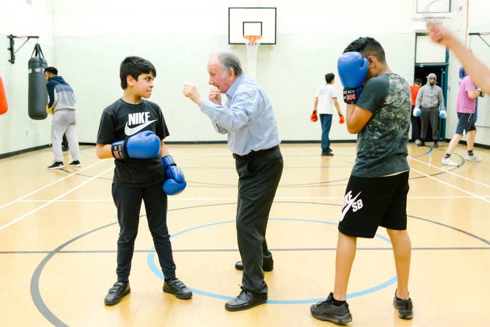 Club Founder Ernie, 81 teaches some young people at Nechells Amateur Boxing