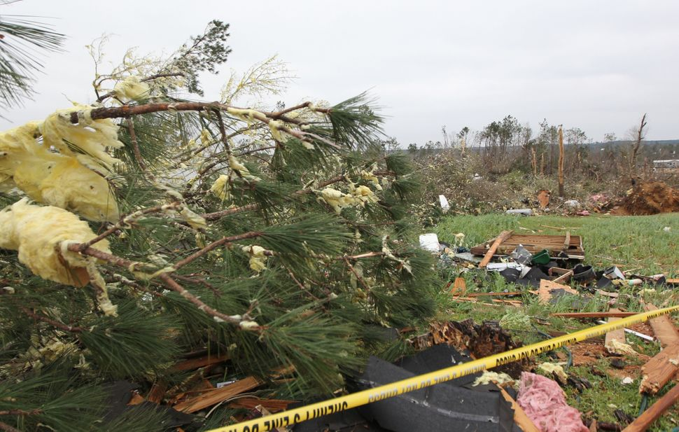 Damage is seen from storms that killed at least 23 people in Beauregard.