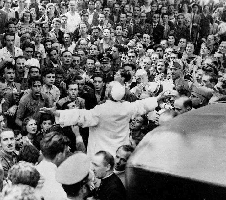 Pius XII on an inspection tour of Rome after an American air raid, Oct. 15, 1943.