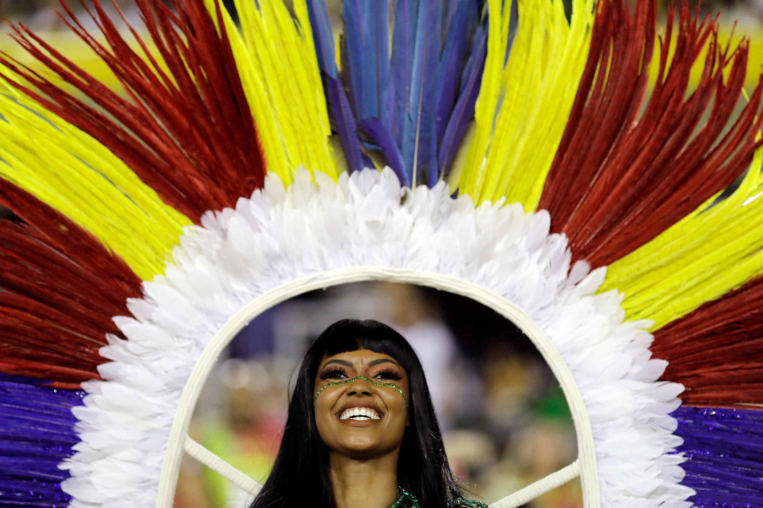 A performer from the Imperatriz Leopoldinense samba school takes part in Carnival.