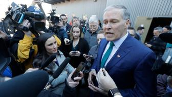 Washington Gov. Jay Inslee takes questions from reporters, Friday, March 1, 2019, during a campaign event at A&R Solar in Seattle. Inslee announced that he will seek the 2020 Democratic presidential nomination, mixing calls for combating climate change and highlights of his liberal record with an aggressive critique of President Donald Trump. (AP Photo/Ted S. Warren)