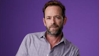 """Luke Perry, a cast member in the CW series """"Riverdale,"""" poses for a portrait during the 2018 Television Critics Association Summer Press Tour, Monday, Aug. 6, 2018, in Beverly Hills, Calif. (Photo by Chris Pizzello/Invision/AP)"""