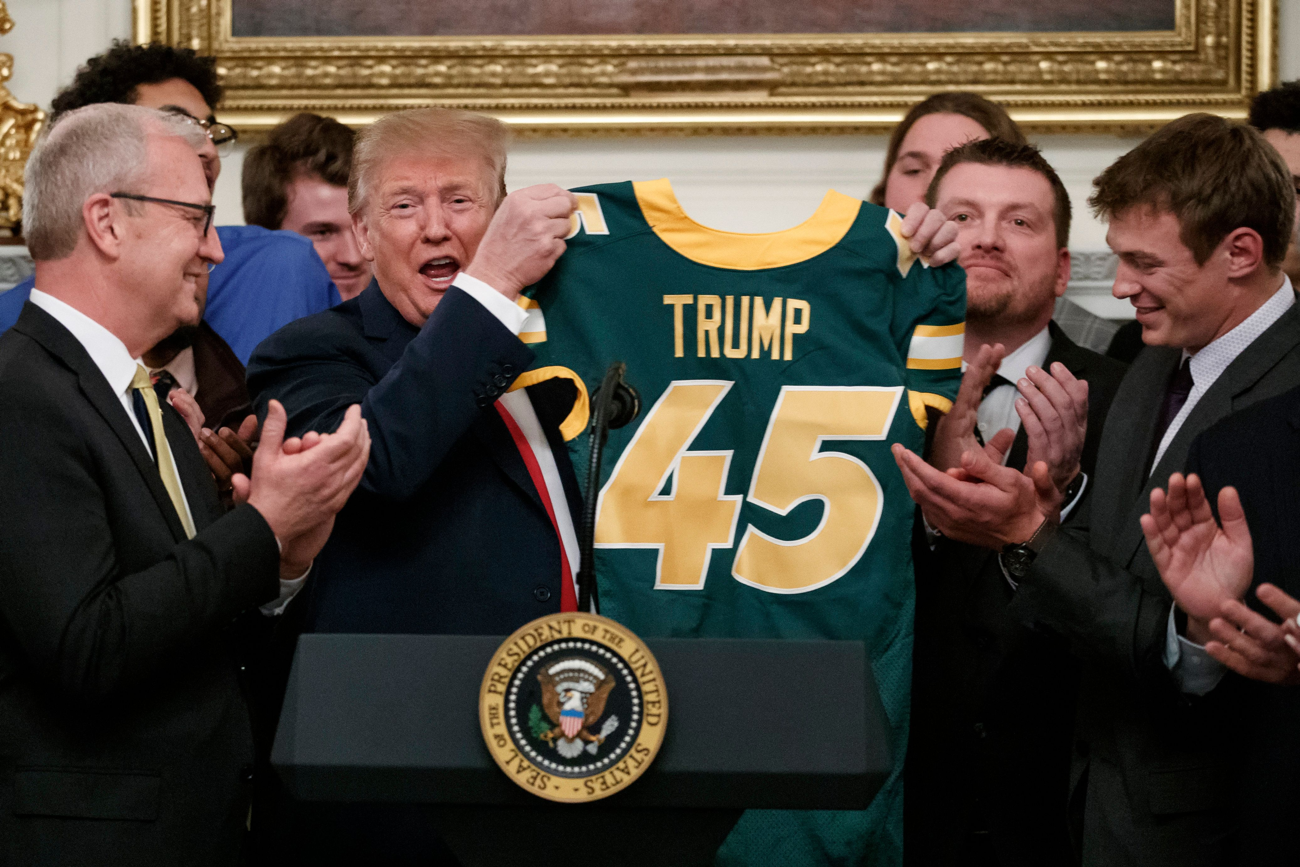 Trump was given a jersey by the football team in the state dining room of the White House